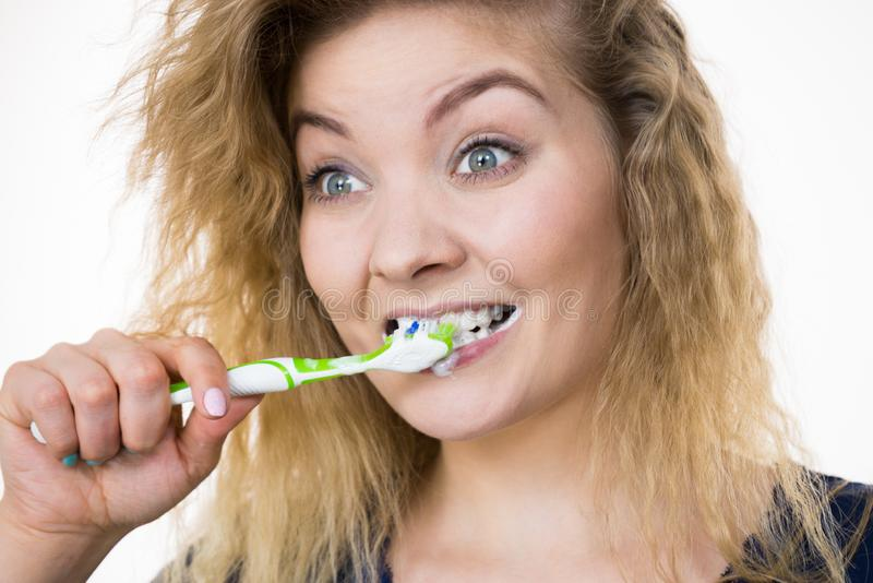 Woman brushing cleaning teeth royalty free stock image