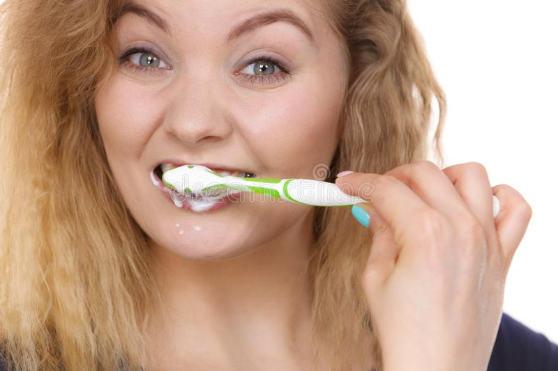 Woman brushing cleaning teeth stock photo