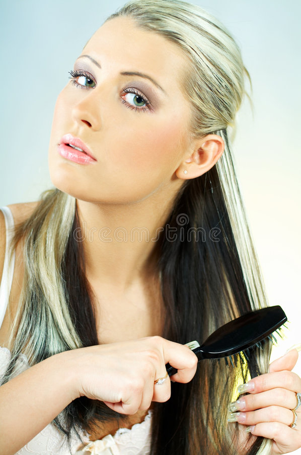 Download Woman brushing hair stock photo. Image of lipstick, body - 598574