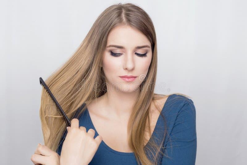 Woman brushing hair royalty free stock image