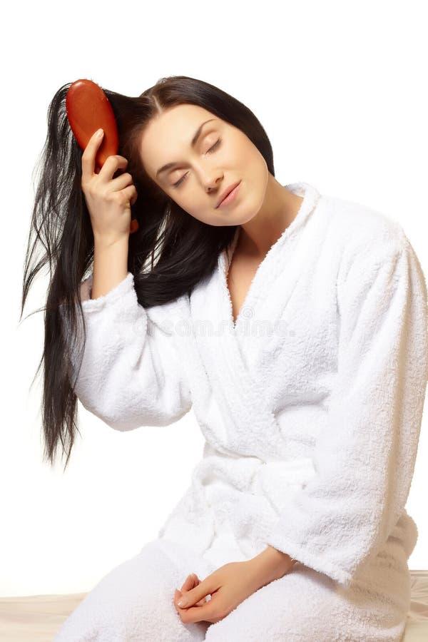 Download Woman brushing her hair stock photo. Image of brushing - 13932844