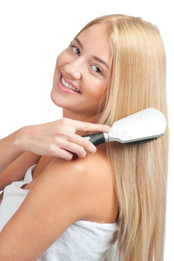 Download Woman Brushing Her Long Hair Stock Photo - Image of beauty, gorgeous: 21366840