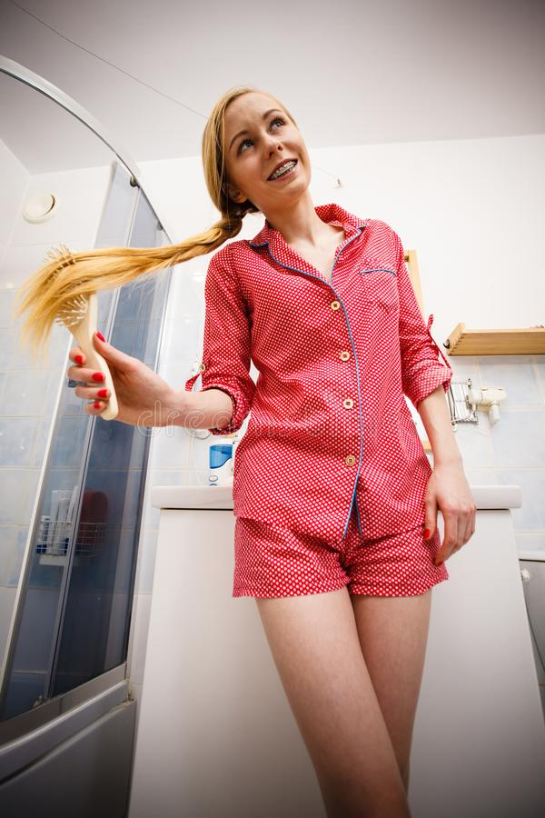Woman brushing her long hair royalty free stock images