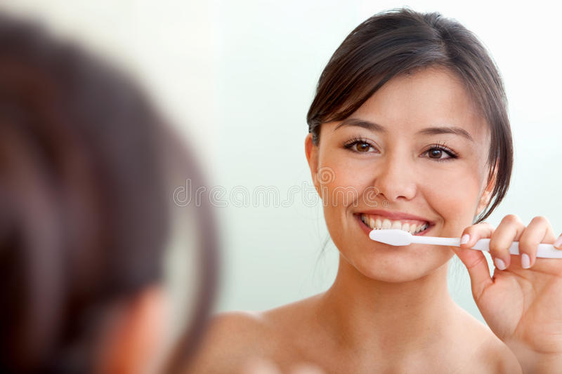 Download Woman brushing her teeth stock photo. Image of cute, happy - 15131376