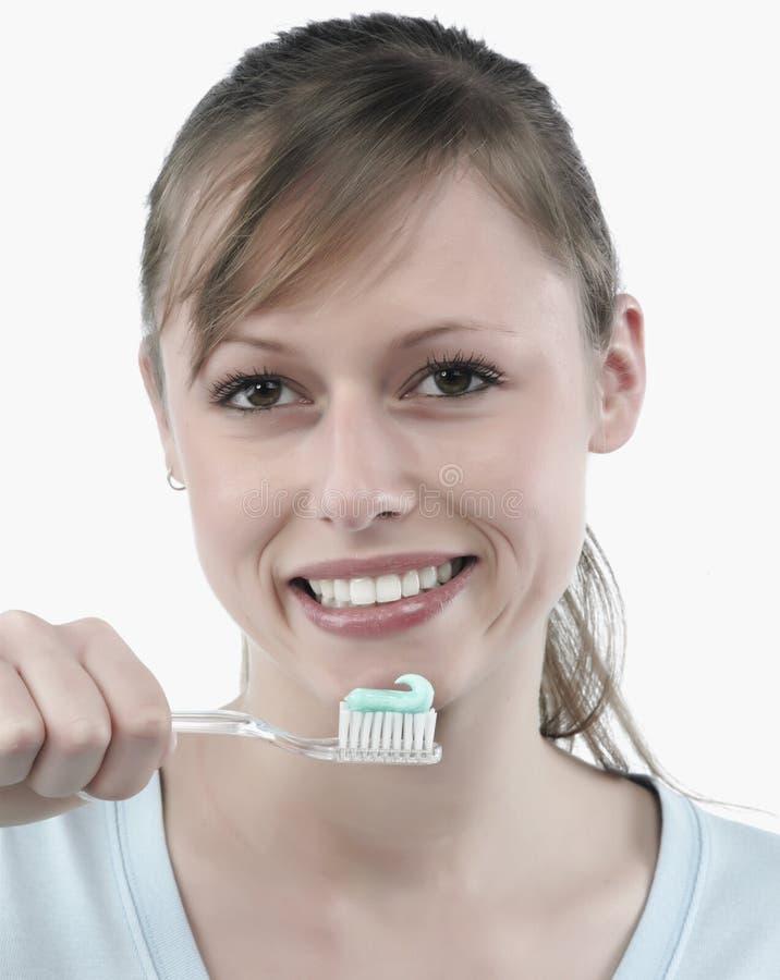 Woman brushing her teeth royalty free stock image