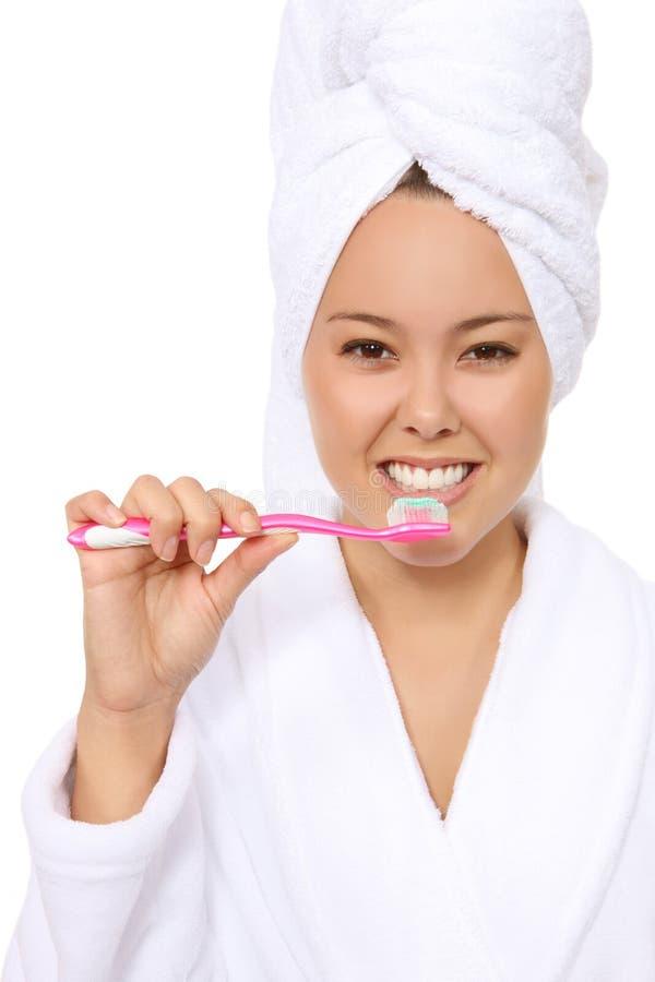 Woman Brushing Teeth stock image