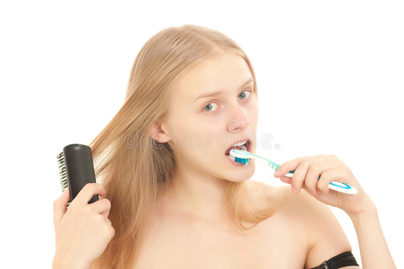Download Woman Brushing Teeth And Comb Hair Stock Photo - Image: 16983626