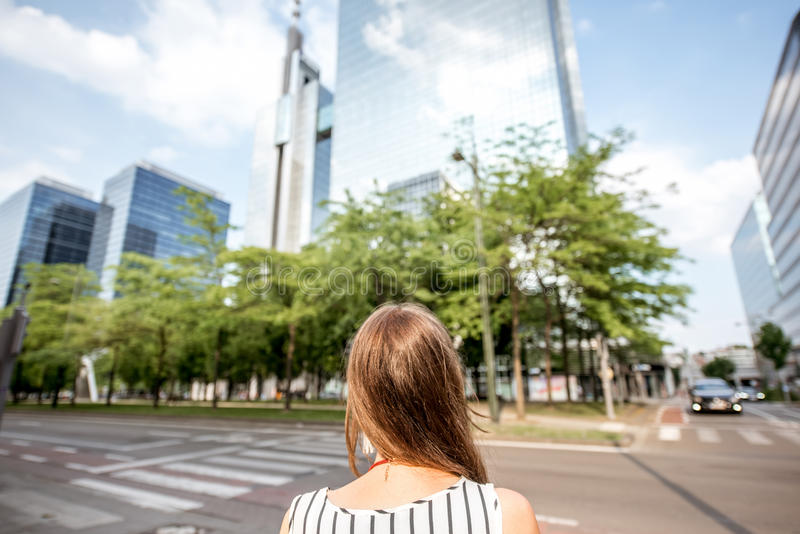 Woman in Brussel. Young businesswoman looking forward on the modern district with skyscrapers in Brussel city, Belgium royalty free stock images