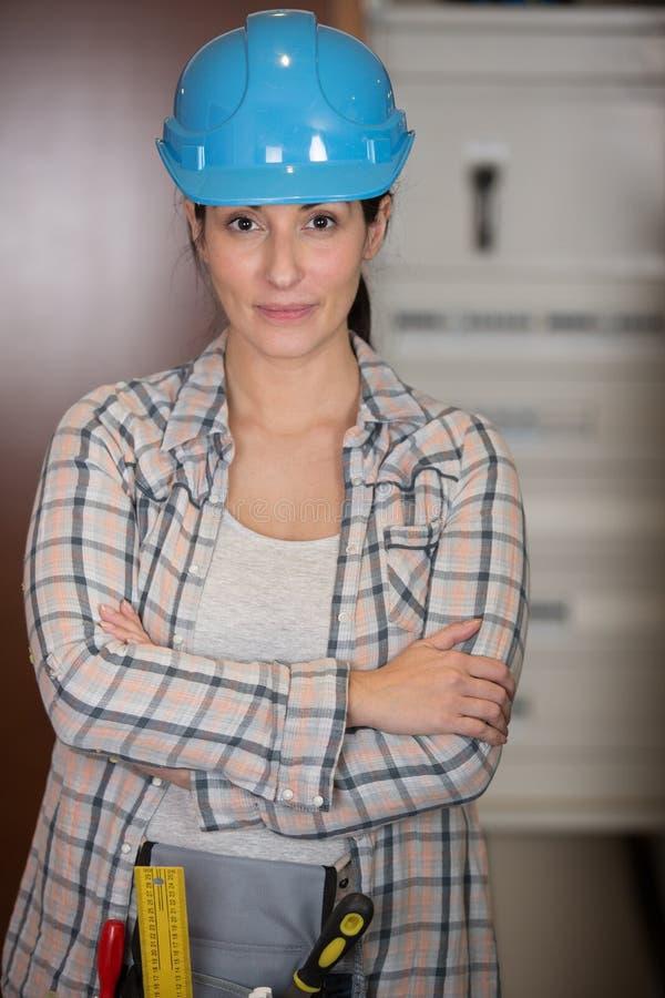 Woman in builder respirator indoor royalty free stock image
