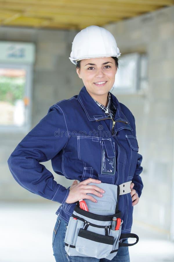 Woman builder smiling at camera royalty free stock photos