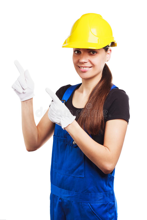 Download Woman Builder In The Uniform And Construction Gloves Stock Photo - Image of girl, yellow: 83709814