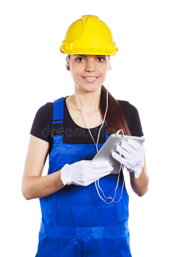Download Woman Builder In The Uniform Holds A Tablet Stock Photo - Image: 83708482