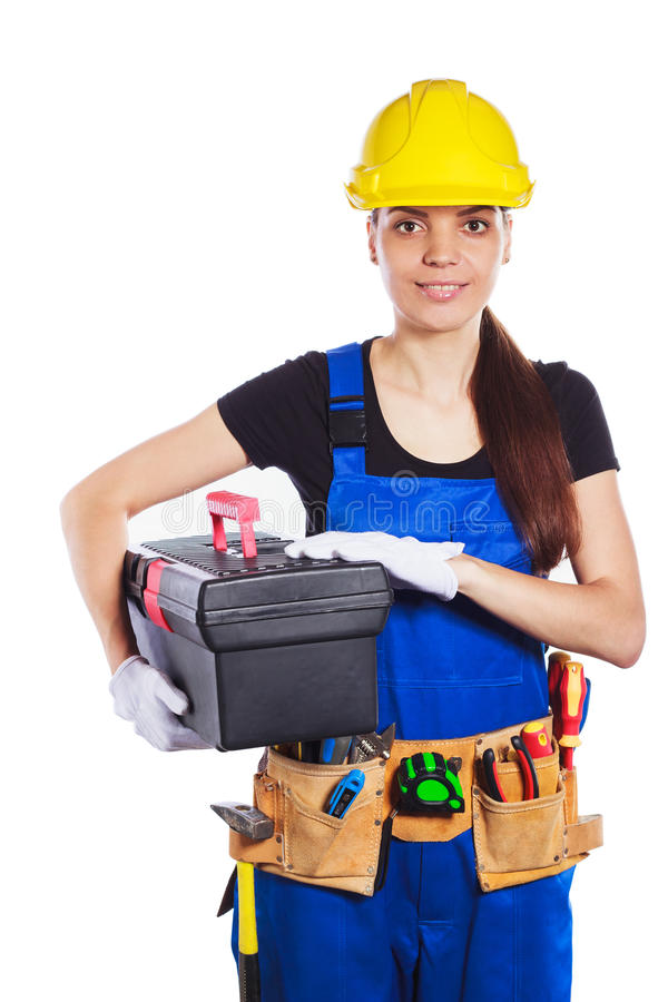 Download Woman Builder In The Uniform Holds A Tool Box Stock Photo - Image: 83709432