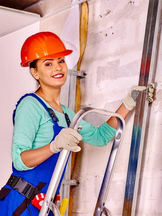 Woman in builder uniform stock photo
