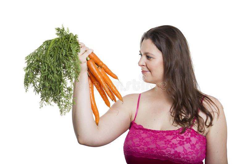 Woman with a bunch of carrots royalty free stock image