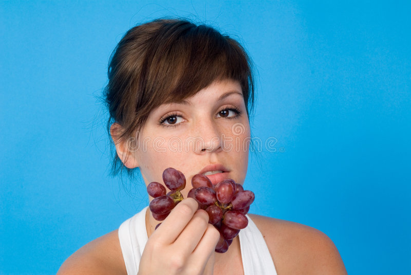 Download Woman with bunch of grapes stock image. Image of looking - 5100647