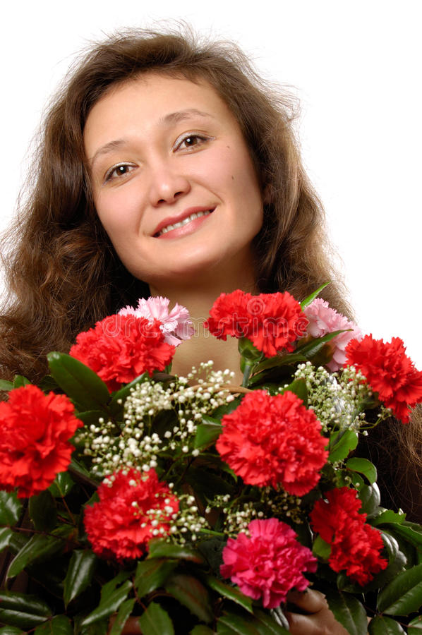 Woman with Bunch of Red Carnations. Young smiling woman with a bunch of red carnations in her hands stock photo