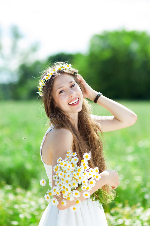 Download Woman With Bunch Of Wildflowers Stock Photo - Image: 25793110