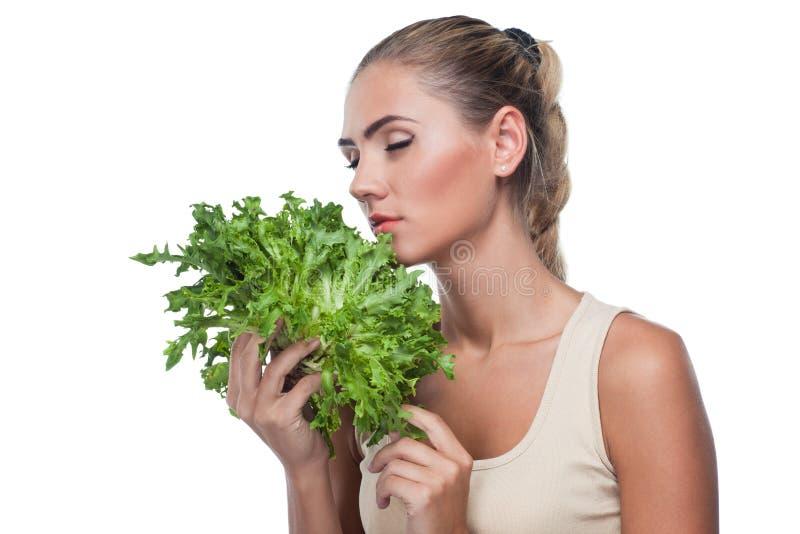 Woman with bundle herbs (salat) stock photo