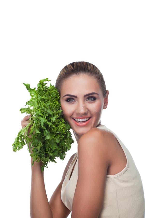 Woman with bundle herbs (salat) stock image