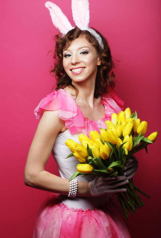 Woman with Bunny Ears holding yellow tulips stock photos