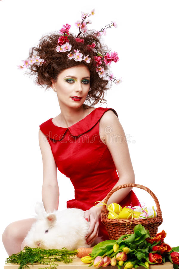 Woman with a bunny, eggs and flowers spring easter concept. Isolated on white royalty free stock photography