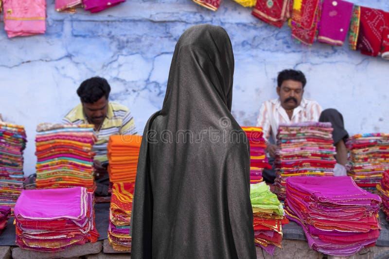 Woman with burca on the market stock photos