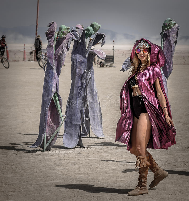 Woman at Burning Man Festival. Woman in fancy dress and colored glasses at the Burning Man Festival, Black Rock Nevada, a creative arts event held annually in royalty free stock photography