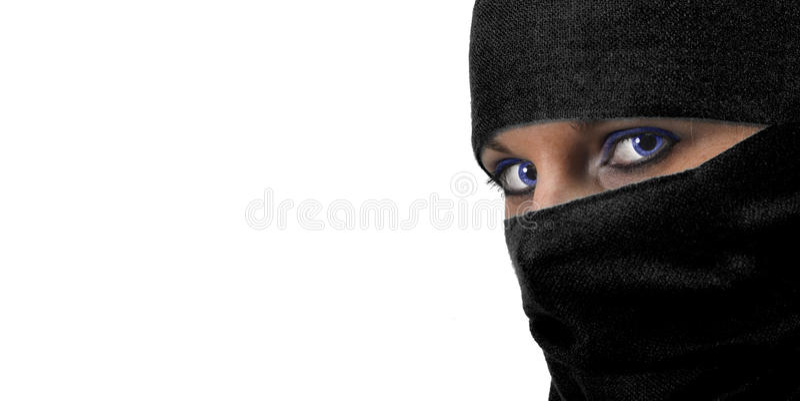 Woman in burqua. A beautiful woman wearing a burqua, or hajib stock images