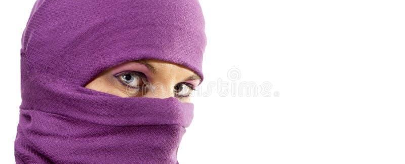 Woman in burqua. A beautiful woman wearing a burqua, or hajib royalty free stock photo
