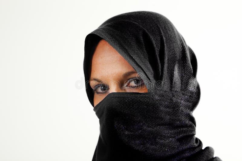 Woman in burqua. A beautiful woman wearing a burqua, or hajib royalty free stock images