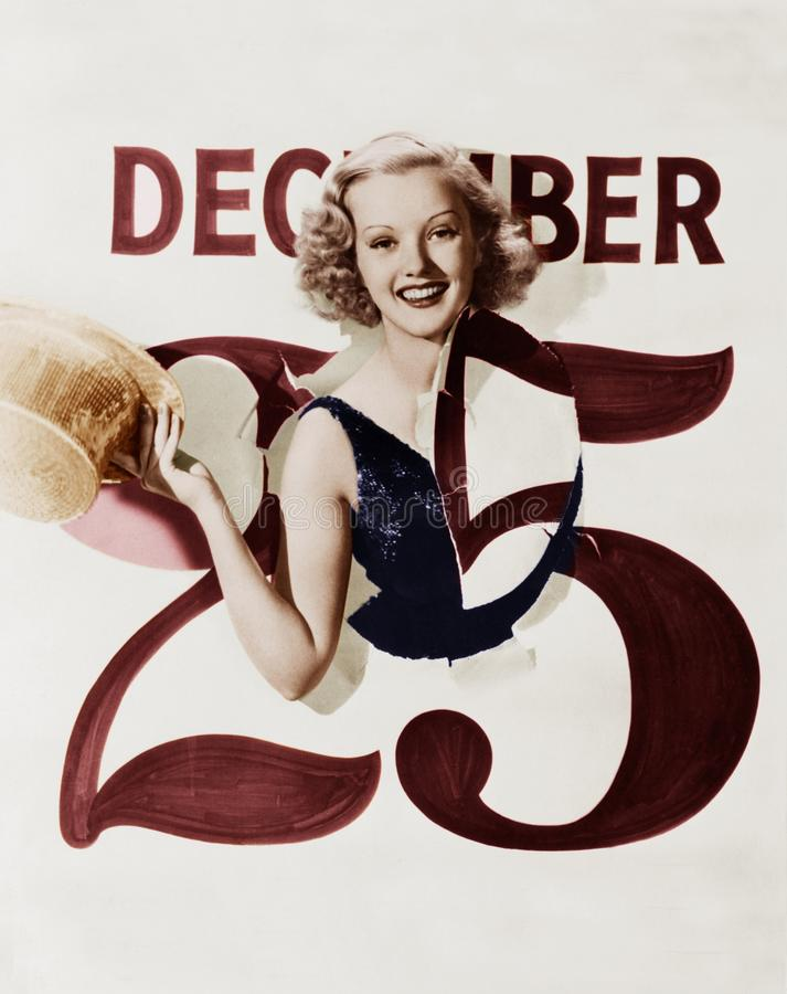 Free Woman Bursting Through Calendar On Christmas Day Stock Photography - 51999422