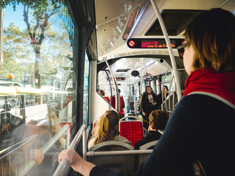 Woman in bus commuting to work home in Barcelona, Spain, public royalty free stock image