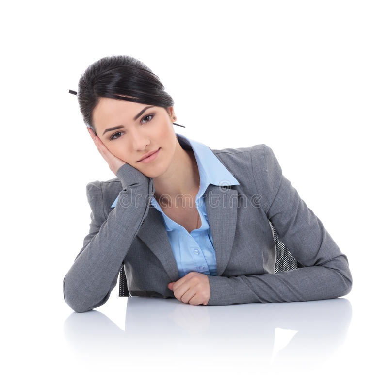 Woman in business clothes sitting at the desk royalty free stock image