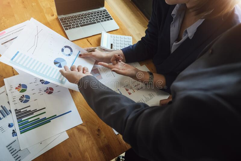 A women business consultant describes a marketing plan to set business strategies for women business owners. business budget stock photography
