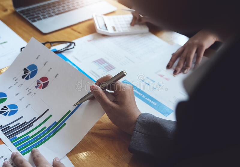 A women business consultant describes a marketing plan to set business strategies for women business owners. business budget royalty free stock image