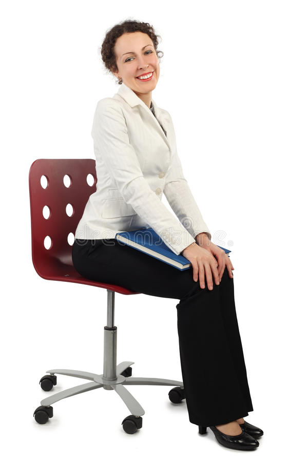 Woman in business dress sitting on chair royalty free stock photo