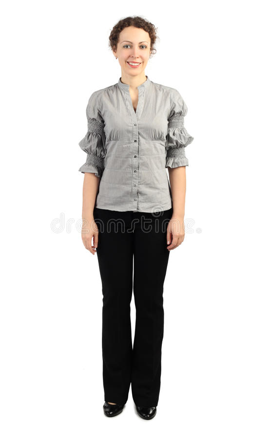 Woman in business dress standing and smiling stock image