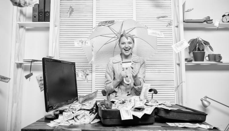 Woman business lady or accountant under umbrella. Financial success. Accountant with pile money hide under umbrella. Accountant enjoy cash rain in office. Cash royalty free stock image
