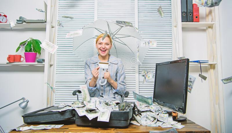Woman business lady or accountant under umbrella. Financial success. Accountant with pile money hide under umbrella. Accountant enjoy cash rain in office. Cash royalty free stock images