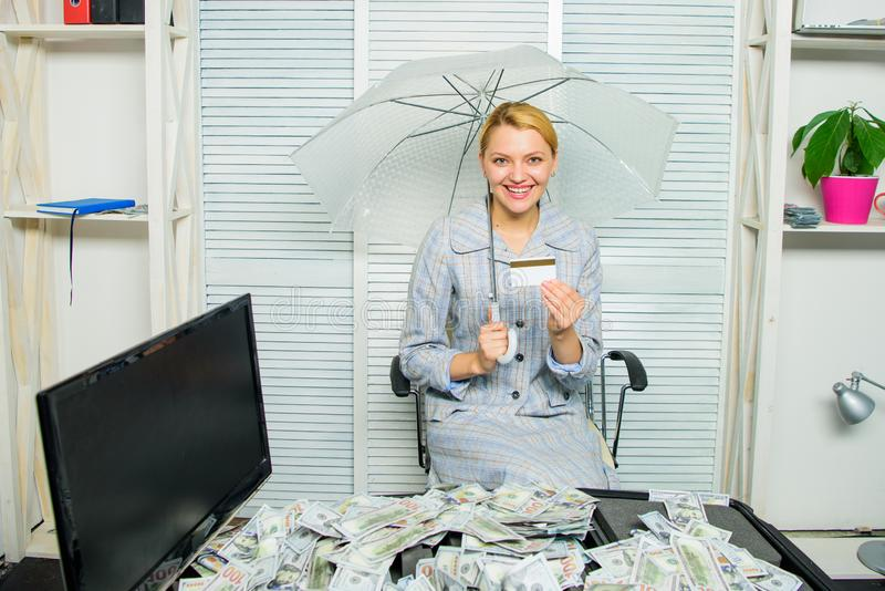 Woman business lady or accountant under umbrella. Richness and profit. Financial success. Accountant with pile money royalty free stock image