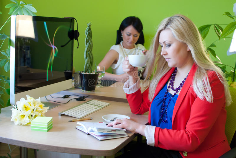 Woman business office drinking coffee break stock images