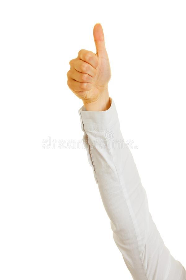 Woman holds thumbs up as success concept stock photography