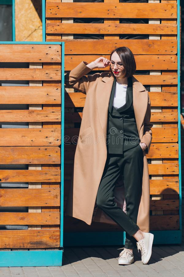 Woman in a business suit posing on the streets royalty free stock images