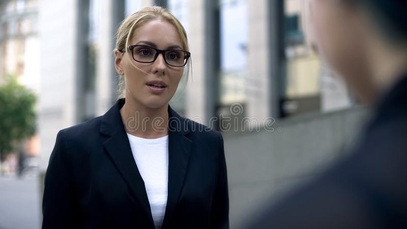 Woman in business suit talking with client, expert in her field, interpreter. Stock photo royalty free stock photo