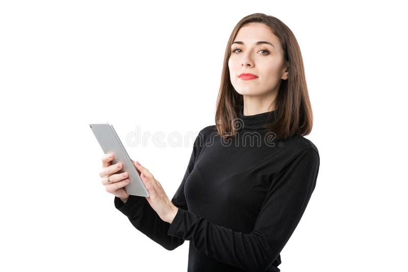 Woman business technology theme. Beautiful young caucasian woman in black shirt posing standing with tablet hands on royalty free stock photography
