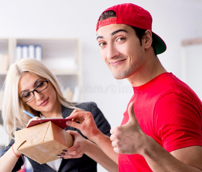 Woman businesswoman receiving mail parcel from courier stock photography