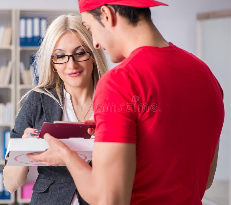 Woman businesswoman receiving mail parcel from courier stock photo
