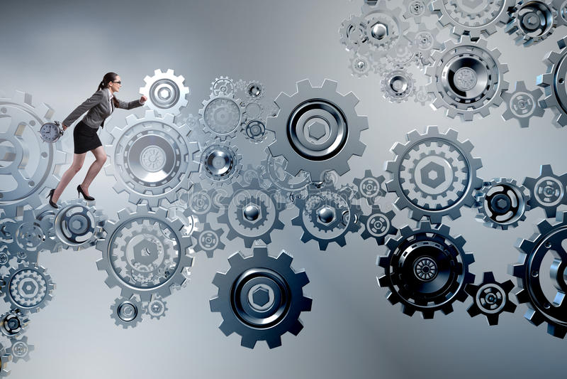 The woman businesswoman walking in cogwheels. Woman businesswoman walking in cogwheels stock photo