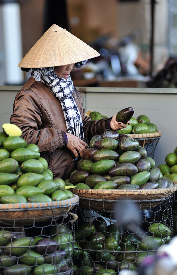 A woman in busy market in Vietnam stock photography